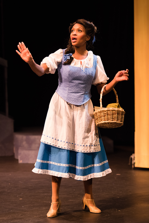 Belle (JANELLE LASALLE), searches for something more than her provincial life in Berkeley Playhouse's production of Disney's Beauty and the Beast, directed by Kimberly Dooley. Performing at the Julia Morgan Theater now through December 23, 2016. Photo by
