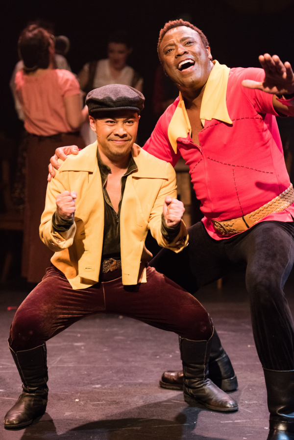 Gaston (PHILLIP PERCY WILLIAMS) and Le Fou (DOMINIC DAGDAGAN) scheme for Belle's hand in Berkeley Playhouse's production of Disney's Beauty and the Beast, directed by Kimberly Dooley. Performing at the Julia Morgan Theater now through December 23, 2016. P