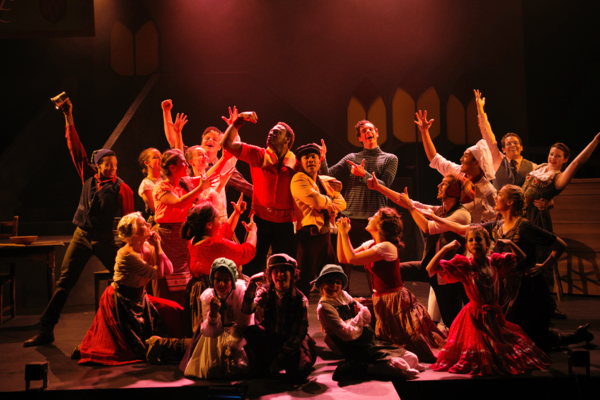 No one fights like Gaston (PHILLIP PERCY WILLIAMS); Le Fou (DOMINIC DAGDAGAN) and the cast fawn over Gaston in Berkeley Playhouse's production of Disney's Beauty and the Beast, directed by Kimberly Dooley. Performing at the Julia Morgan Theater now throug