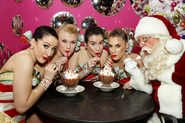 -  New York, NY - 11/29/16 - The Radio City Rockettes, Santa Claus, and Serendipity 3 introduce Santa's 30th anniversary peanut butter & jelly frrrozen hot chocolate  -Pictured: The Radio City Rockettes with Santa Claus -Photo by: Patrick Lewis/Starpix