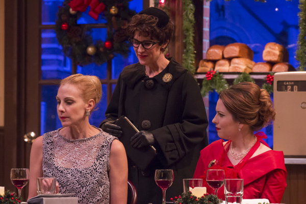 Actors Elizabeth Marshall Black, Christy Watkins and Katie Fridsma star in A. D. Players' nostalgic Christmas drama O Little Town of Bagels, Teacakes and Hamburger Buns, playing through December 23 at Houston's Grace Theater.