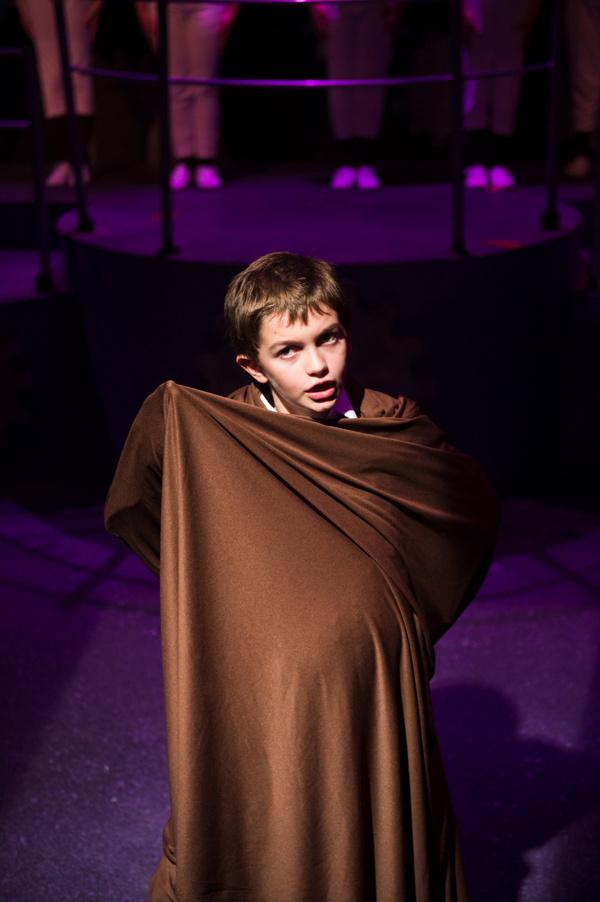 Aidan Chomicki as Augustus Gloop in Roald Dahl's Willy Wonka at NextStop Theatre. Photo by Traci J. Brooks Studios.