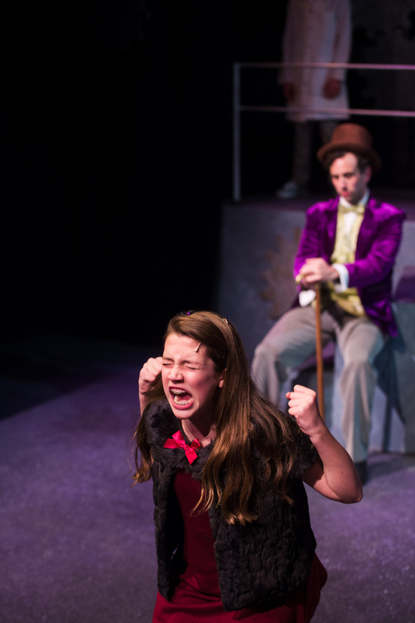 Sissy Sheridan as the show-stopping Veruca Salt with onlooking John Loughney as Willy Wonka in Roald Dahl's Willy Wonka at NextStop Theatre. Photo by Traci J. Brooks Studios.