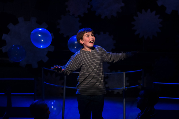Holden Browne flying as Charlie Bucket in Roald Dahl's Willy Wonka at NextStop Theatre. Photo by Traci J. Brooks Studios.