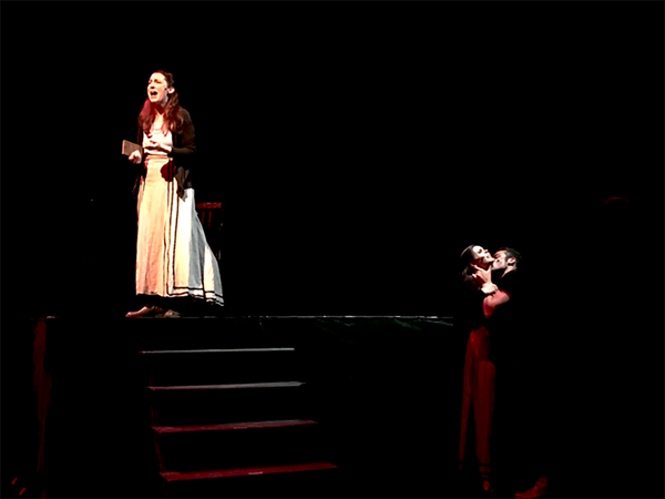 Dianna Graham (Ana), Ellie Smith (Gretchen), and Cooper Howell (Johann Faustus) in wo Photo
