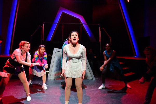 (center) Courtney Mack with (back, l to r) Genevieve Perrino, Mari Uchida, Vasily Deris, Tyler Symonè and Caleb Baze in Underscore Theatre Company's Chicago premiere of TONYA AND NANCY: THE ROCK OPERA. Photo by Evan Hanover.