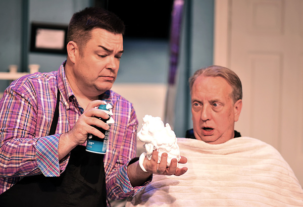 Nick O'Brien (Jeff Stockberger), right, watches as Tony Whitcomb (Daniel Klingler) fills his hand with shaving cream as he prepares to give Nick a shave