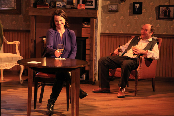 (left to right) Sarah Wellington and Brad Armacost in Irish Theatre of Chicago's production of THE WEIR by Conor McPherson, directed by Siiri Scott. Photo by Emily Schwartz.
