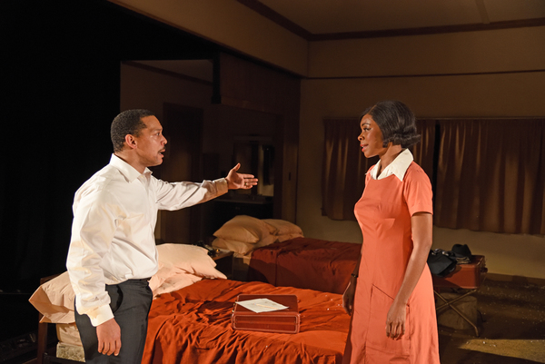​From left to right: Mia Ellis as Camae and Joe Wilson, Jr. as Dr. Martin Luther King, Jr. in Katori Hall's The Mountaintop directed by Kent Gash at Trinity Rep. Set design by Jason Sherwood, costume design by Kara Harmon, lighting design by Dawn Chia