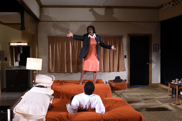 Mia Ellis as Camae and Joe Wilson, Jr. as Dr. Martin Luther King, Jr. in Katori Hall's The Mountaintop directed by Kent Gash at Trinity Rep. Set design by Jason Sherwood, costume design by Kara Harmon, lighting design by Dawn Chiang, sound design by Jus
