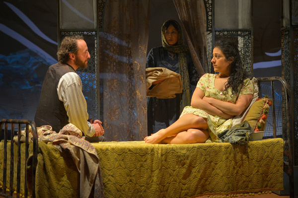 Laila (Nadine Malouf, R) agrees to marry Rasheed (Haysam Kadri), as Rasheed's wife, Mariam (Kate Rigg) watches on