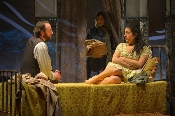 Laila (Nadine Malouf, R) agrees to marry Rasheed (Haysam Kadri), as Rasheed's wife, Mariam (Kate Rigg) watches on