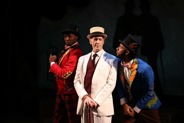 (L to R) Denzel Tsopnang as Mr. Bones, Larry Yando as The Interlocutor and Mark J.P. Hood as Mr Tambo in Porchlight Music Theatre's The Scottsboro Boys