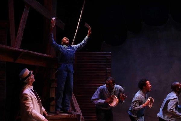 (Standing on box) Cameron Goode as Eugene Williams in Porchlight Music Theatre's The Scottsboro Boys