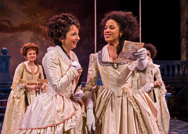 The Princess (Jennie Greenberry, at right) and Rosaline (Laura Rook) gleefully read through a love letter mistakenly delivered into the wrong hands, as Katherine (Taylor Blim) and Maria (Jennifer Latimore) look on in Chicago Shakespeare Theater's produc