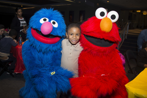 Sesame Street Live characters helped children from SCO Family of Services make friendship bracelets.