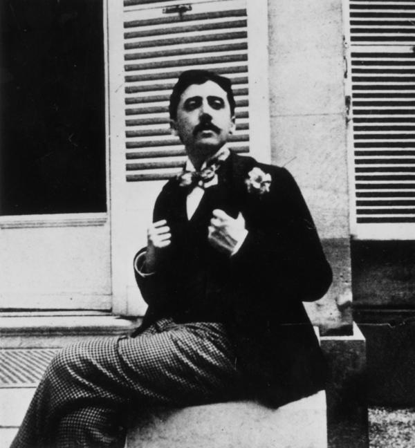 In this photograph, taken circa 1910, Marcel Proust poses outside a window. The image places Proust roughly a few years before the publication of the first volume his masterpiece, <em>In Search of Lost Time</