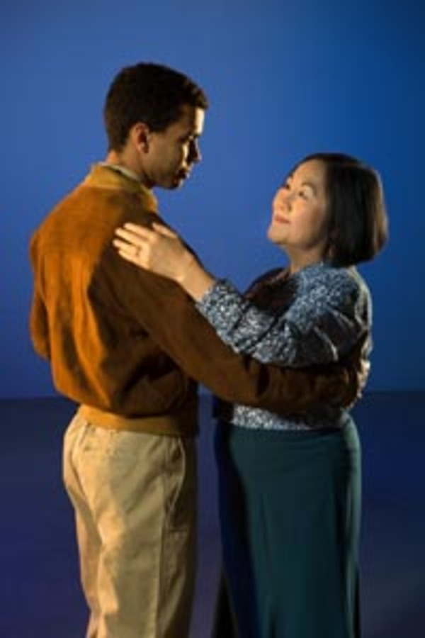 Her GI husband Eamon Jameson (William Thomas Hodgson) reappears as his youthful self to Noriko Matsuda Jameson (Emily Kuroda) in TheatreWorks Silicon Valley's regional premiere of Velina Hasu Houston's international comic drama, Calligraphy, presented at the Lucie Stern Theatre in Palo Alto, March 8 to April 2, 2017. Photo by Kevin Berne