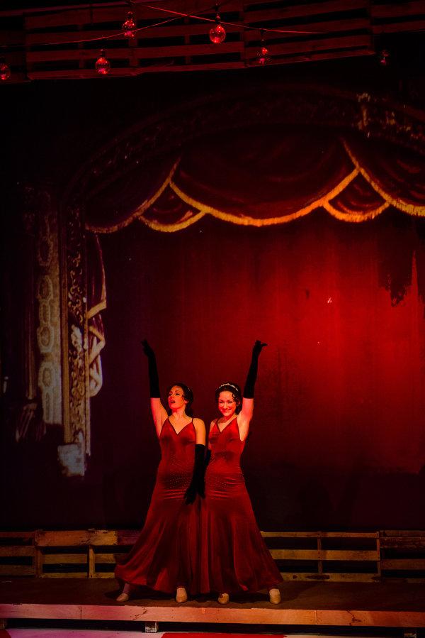 The Hilton Sisters (Jenna Pastuszek, Ashley Sweetman) perform on stage