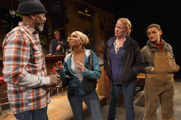 John Earl Jelks as Brucie, James Colby (standing behind the bar) as Stan, Michelle Wilsonas Cynthia, Johanna Day as Tracey and Alison Wright as Jessie IN SWEAT. Photo by Joan Marcus