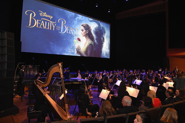 """NEW YORK, NY - MARCH 13:  An orchestra performs at the New York special screening of Disney's live-action adaptation """"Beauty and the Beast"""" at Alice Tully Hall on March 13, 2017 in New York City.  (Photo by Jamie McCarthy/Getty Images for Walt Disney Stud"""