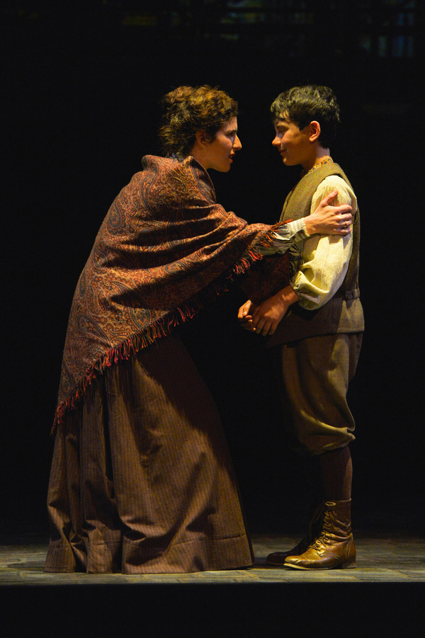 From L-R: Rebecca (Kyra Miller) explains to her son, David (Jonah Broscow) the aftermath of the fire in TheatreWorks Silicon Valley's Rags, a musical saga of immigrant America. Rags is presented at the Mountain View Center for the Performing Arts April no