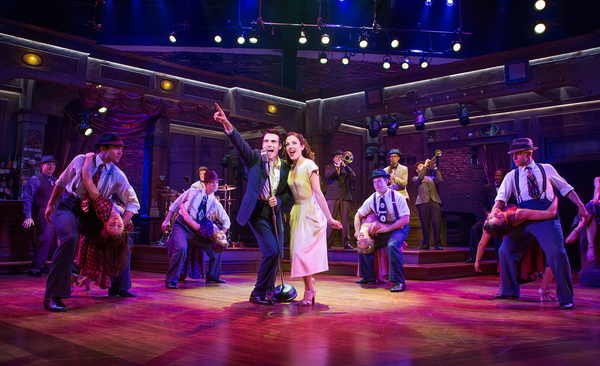 Corey Cott and Laura Osnes (center) with the company of BANDSTAND