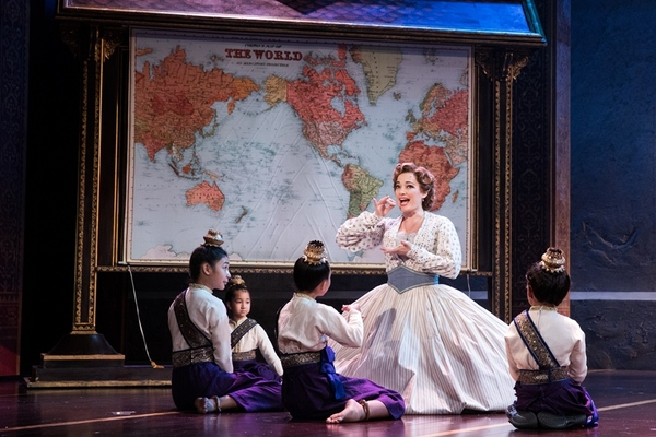 Laura Michelle Kelly as Anna and the Royal Children of Rodgers & Hammerstein's The King and I. Photo by Matthew Murphy