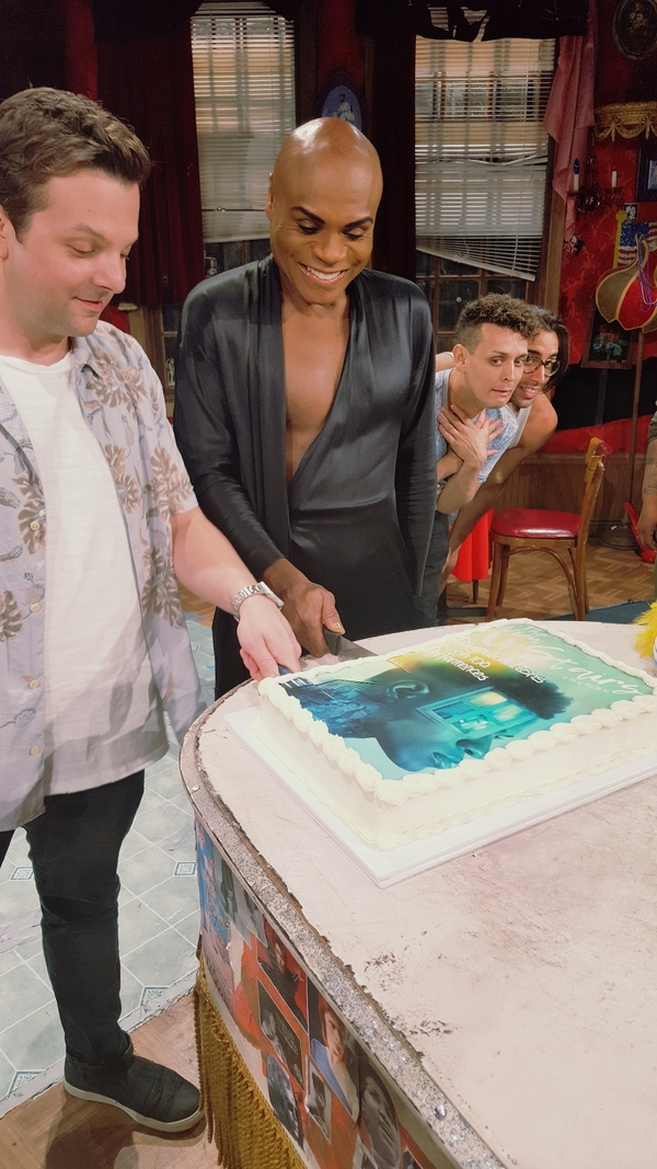 Cutting the cake with director Scott Ebersold, and cast members Nathan Lee Graham, Michael Longoria and Anthony Alfaro.