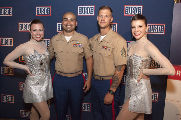 The Rockettes pose for a photo with service men during the Fleet Week NY 2017 Official Kick-Off Party.