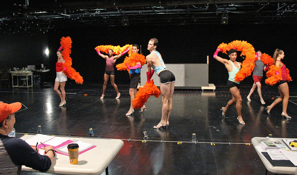 "Director Bert Bernardi (lower left corner) looks on in a rehearsal of the opening number ""We Are What We Are� performed by The Chagelles in Cortland Repertory Theatre's production of the flamboyant musical ""La Cage Aux Folles� running from June"