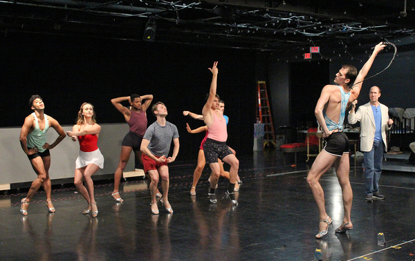 """Brian Runbeck (far right) as Georges and the Chagelles in a rehearsal photo of the opening number """"We Are What We Areâ€� in Cortland Repertory Theatre's production of the flamboyant musical """"La Cage Aux Follesâ€� running from June 21 â€"""" July 8."""