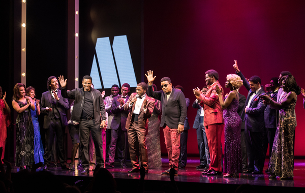Jackie Jackson and Tito Jackson on stage with the West End company of Motown the Musical