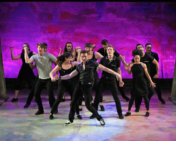 """Dan Lusardi (center) as Ren McCormick and the cast perform the opening number �""""Footloose"""" in Cortland Rerpertory Theatre's production of �""""Footloose"""", running July 12 – 29."""