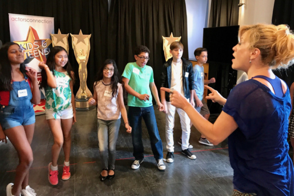 Teens group at Actors Connection Performing Arts Camp train in movie musicals with Broadway Star Felicia Finley.