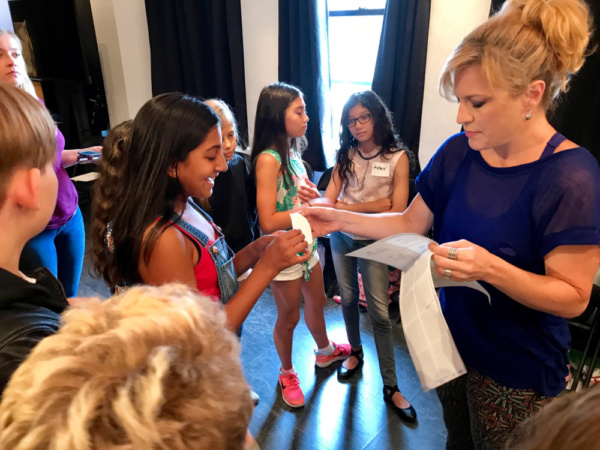 Felicia Finley assigns characters for the musical acting lesson at Actors Connection Performing Arts Camp July 2017.
