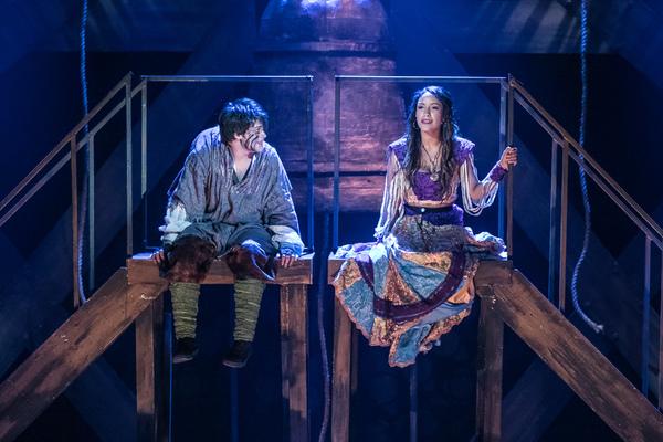 Haden Rider as Quasimodo and Julissa Sabino as Esmeralda in HUNCHBACK. Photo by Da... Photo
