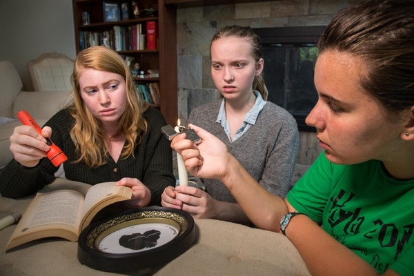 Three teen friends attempt to conjure spirits in a secret midnight ceremony, in †Photo