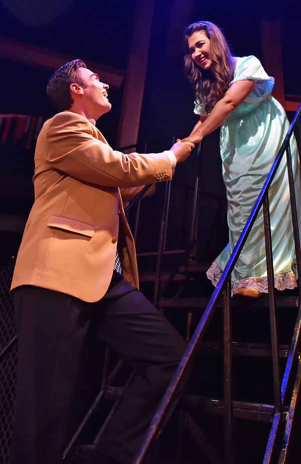 Meeting in secret on a fire escape, Tony (Glenn DeVar) and Maria (Courtney Cheatham) sing 'Tonight' about their newfound love