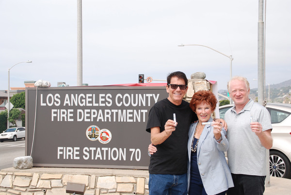 Happy Days Cast members, Anson Williams, Marion Ross and Don Most gather outside the LA County Fire Dept in Malibu to raise awareness