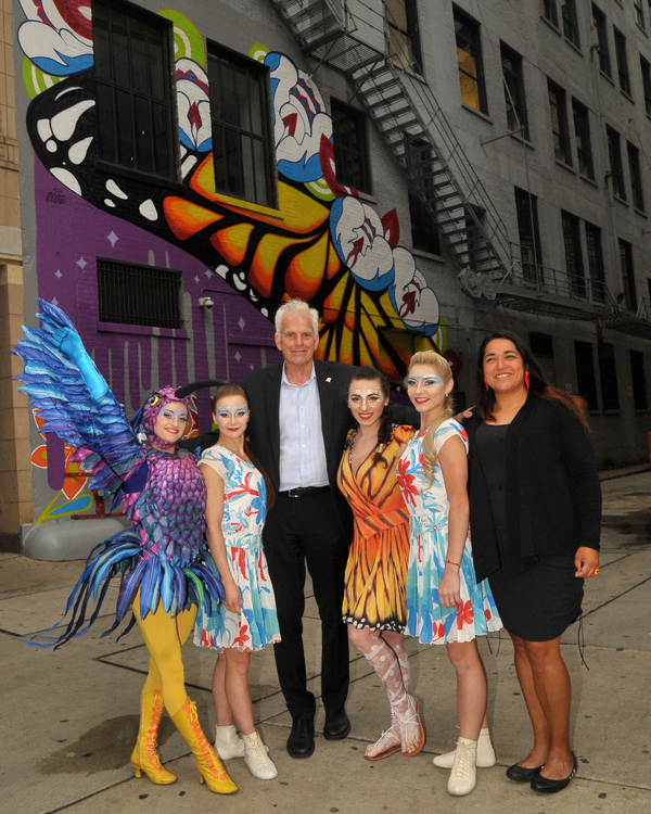Cirque du Soleil's LUZIA artists with Department of Cultural Affairs and Special Events Commissioner Mark Kelly (center) and Chicago artist Gloria 'Gloe' Talamantes (right) at the dedication of Talamantes' LUZIA-inspired mural.