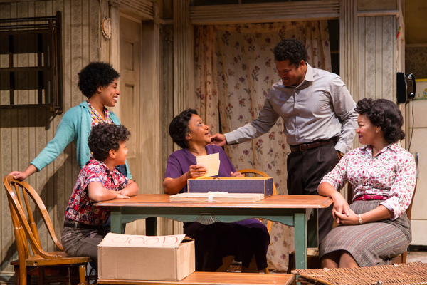 Jasmine Batchelor (Beneatha Younger), Owen Tabaka (Travis Younger), Brenda Pressley (Lena Younger), Brandon J. Dirden (Walter Lee Younger) and Crystal A. Dickinson (Ruth Younger) in A Raisin in the Sun at Two River Theater.