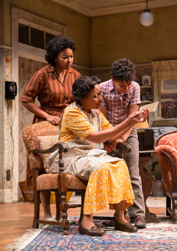 Crystal A. Dickinson (Ruth Younger), Brenda Pressley (Lena Younger) and Owen Tabaka (Travis Younger) in A Raisin in the Sun at Two River Theater.