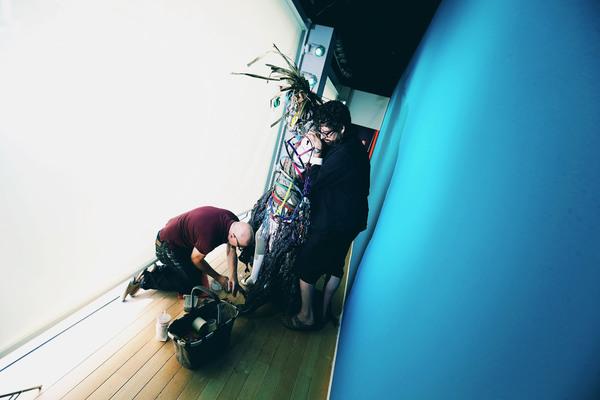Machine Dazzle installing a mannequin at Nieman Marcus Photo