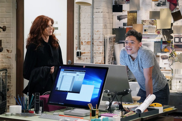 """WILL & GRACE -- """"11 Years Later"""" Episode 101 --  Pictured: (l-r) Debra Messing as Grace Adler, Anthony Ramos as Tony -- (Photo by: Chris Haston/NBC)"""