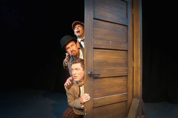 Steven Lane as Sherlock Holmes, Simon Needham as Dr. Watson, and Chris Crawford as Sir Henry star in Orlando Shakespeare Theater's production of The Hound of the Baskervilles. Photo by Luke Evans.