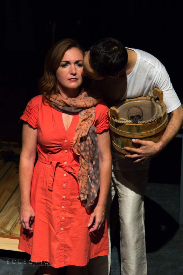Henrietta (Kelly Levander) shares a heartbreaking story with Jesus (Matthew Harris) in the opening moments of THE LAST DAYS OF JUDAS ISCARIOT at Eclectic Full Contact Theatre  Tickets available now at eclectic-theatre.com