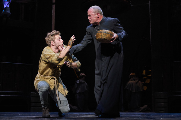 Quasimodo (Corey Mach*) is reprimanded by Dom Claude Frollo (Tom Ford*).