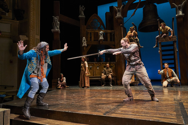 Clopin Trouillefou (Alex Syiek*) is confronted by Phoebus De Martin (Jon Loya*) with  Photo