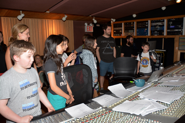 Becky Gulsvig, Justin Collette and the kids listening to the recording